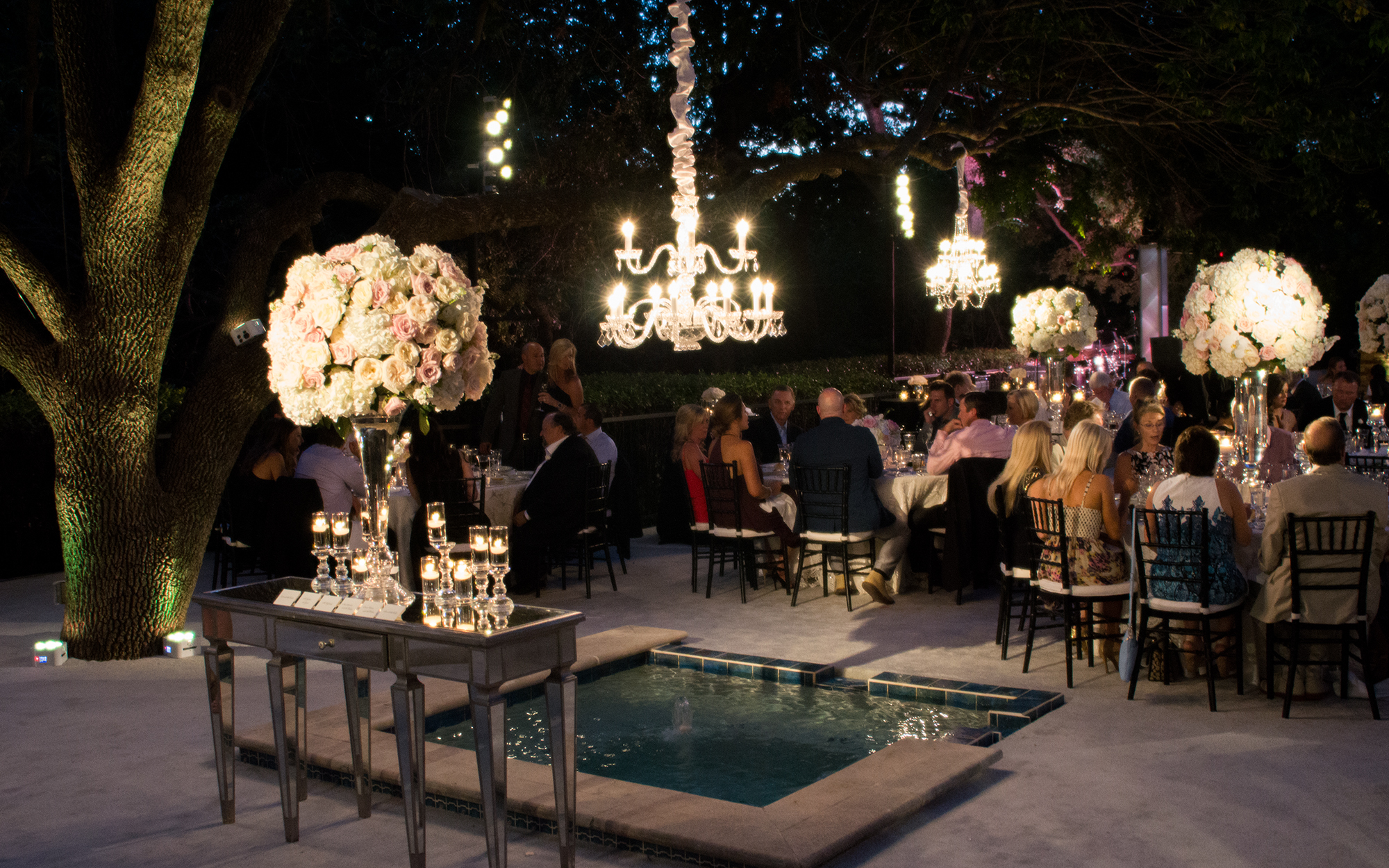 Chandeliers and decor lighting at outdoor wedding reception
